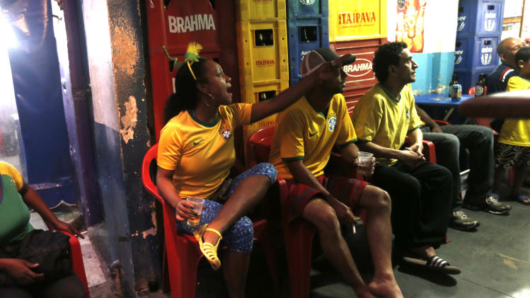 Brazil fans react during the game against Cameroon during the 2014 soccer World Cup at the Cantagalo favela in Rio de Janeiro, Brazil, Monday, June 23, 2014. Brazil's Neymar scored twice in the first half to lead Brazil to a 4-1 win over Cameroon on Monday, helping the hosts secure a spot in the second round of the soccer World Cup. (AP Photo/Silvia Izquierdo)