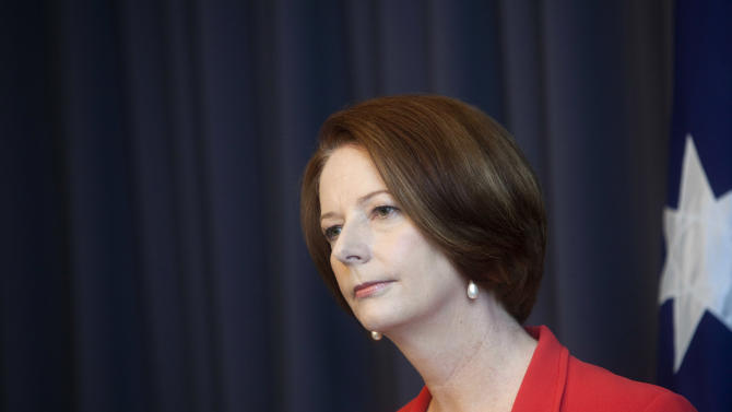 Australian Prime Minister Julia Gillard holds a press conference after winning a leadership challenge in Canberra, Australia, Monday, Feb. 27, 2012. Gillard easily won an internal party vote Monday against the colleague she deposed two years ago, Kevin Rudd, and declared that she had put down the internal strife that has undermined her unpopular government for months. (AP Photo/Andrew Taylor)