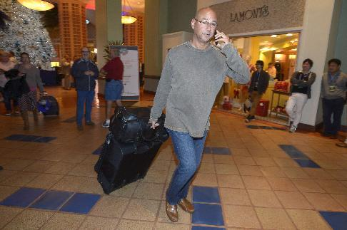Cleveland Indians manager Terry Francona leaves after the conclusion of baseball's winter meetings in Lake Buena Vista, Fla., Thursday, Dec. 12, 2013