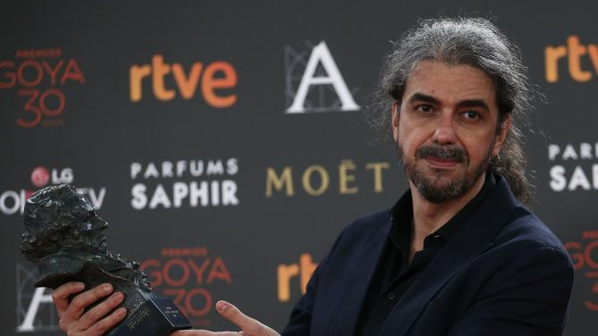 Director Leon de Aranoa, who won the Best Adapted Screenplay award, holds his trohpy during the Spanish Film Academy's Goya Awards ceremony in Madrid