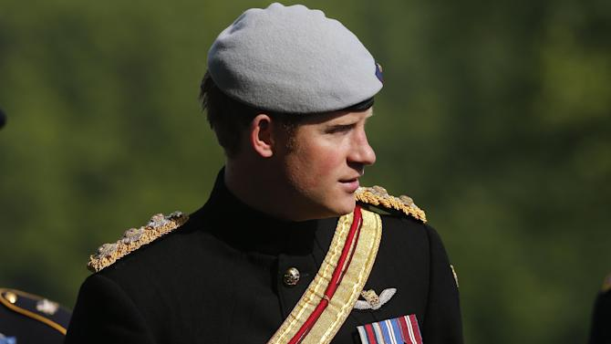 England's Prince Harry visits Section 60 at Arlington National Cemetery, Friday, May 10, 2013. The British soldier-prince is spending most of his week in the U.S. honoring the wounded and the dead of war.  (AP Photo/Charles Dharapak, Pool)