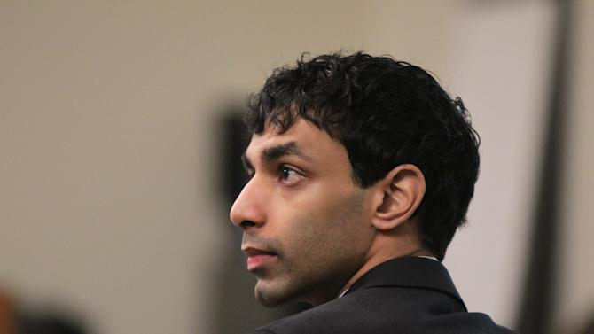 Jurors see video of interview in webcam spy case