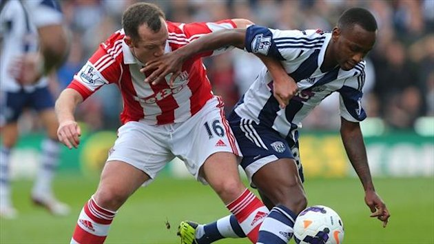 Charlie Adam, left, and Saido Berahino battled it out in a goalless stalemate