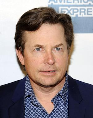 """FILE - In this April 28, 2012 file photo, actor Michael J. Fox attends the premiere of """"The Avengers"""" during the 2012 Tribeca Film Festival in New York. Fox is planning a return to series TV and will star in a sitcom that's in development at Sony Pictures Television according to people familiar with the situation who spoke on condition of anonymity. (AP Photo/Evan Agostini, file)"""