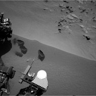 Three bite marks left in the Martian ground by the scoop on the robotic arm of NASA's Mars rover Curiosity are visible in this image taken by the rover's right Navigation Camera during the mission's 69th Martian day, or sol (Oct. 15, 2012). The