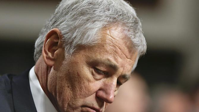 FILE - In this Jan. 31, 2013, file photo  Republican Chuck Hagel, a former two-term GOP senator from Nebraska and President Obama's choice for Defense Secretary, testifies before the Senate Armed Services Committee during his confirmation hearing on Capitol Hill in Washington. A Senate panel on Wednesday, Feb. 6, 2013, abruptly postponed a vote on Chuck Hagel's nomination to be defense secretary amid Republican demands for more information from President Barack Obama's nominee about his paid speeches and business dealings (AP Photo/J. Scott Applewhite, File)