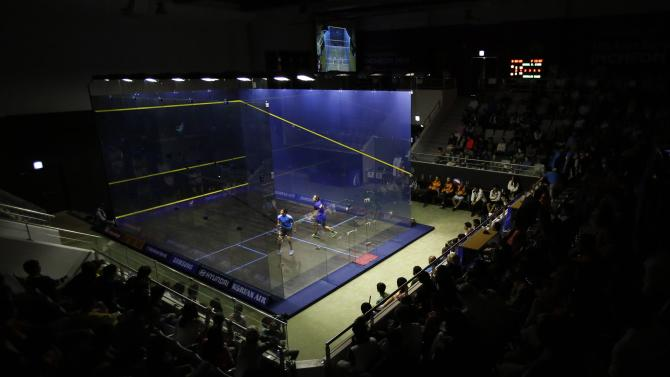 Kuwait's Almezayen competes against India's Saurav in their men's singles gold medal match for squash at the Yeorumul Squash Courts during the 17th Asian Games in Incheon