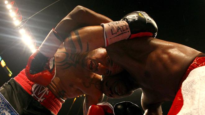 (L-R) Miguel Cotto And Floyd Mayweather Jr. Hold Getty Images
