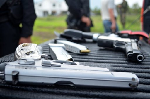 <p>View of weapons seized from members of the drug gang Los Zetas on June 1. A top leader of the feared cartel was among 14 members indicted in the United States for money laundering after a raid which nabbed his brother, officials said.</p>