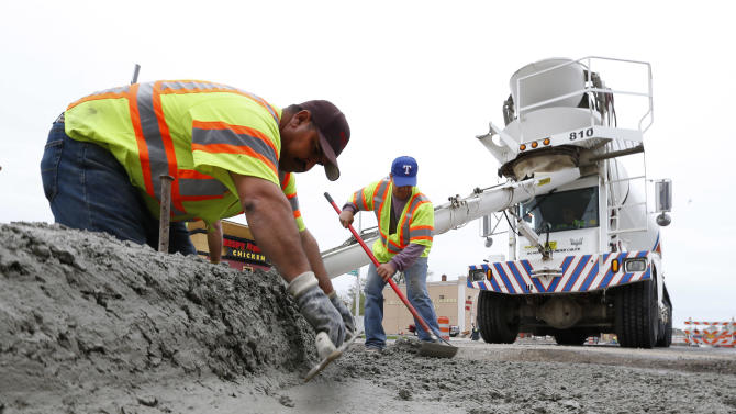 Road construction is shown in Detroit, Tuesday, May 5, 2015. Michigan voters were deciding Tuesday whether to approve higher taxes to improve the state's deteriorating roads and bridges. Proposal 1, a constitutional amendment subject to a statewide vote, would raise Michigan's 6 percent sales tax to 7 percent to trigger $1.3 billion more a year for highways, roads, bridges and public transit.  (AP Photo/Paul Sancya)