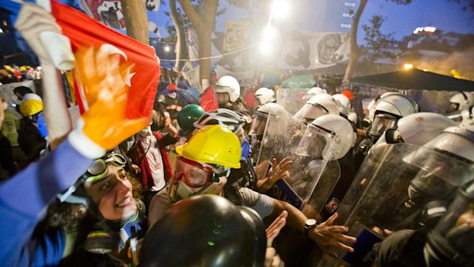 FILE- In this Saturday, June 15, 2013, file photo, protesters try to resist the advance of riot police in Gezi park in Istanbul, Turkey. Protesters will press on with their sit-in at an Istanbul park, an activist said Saturday, defying government appeals and a warning from Prime Minister Recep Tayyip Erdogan.(AP Photo/Vadim Ghirda, File)