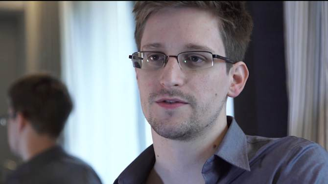 This photo provided by The Guardian Newspaper in London shows Edward Snowden, who worked as a contract employee at the National Security Agency, on Sunday, June 9, 2013, in Hong Kong. The National Security Agency, working with the British government, has secretly been unraveling encryption technology that billions of Internet users rely upon to keep their electronic messages and confidential data safe from prying eyes, according to published reports Thursday, Sept. 5, 2013, based on internal U.S. government documents.(AP Photo/The Guardian, Glenn Greenwald and Laura Poitras)