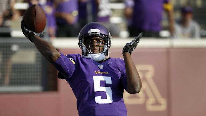 Minnesota Vikings quarterback Teddy Bridgewater throws during warmups before a preseason NFL football game against the Oakland Raiders in Minneapolis, Friday, Aug. 8, 2014