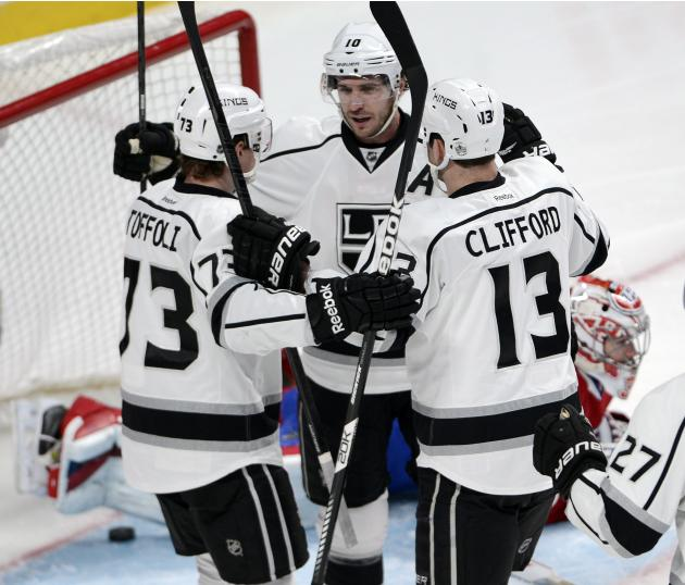 Los Angeles Kings center Tyler Toffoli (73) celebrates with teammates Mike Richards (10) and Kyle Clifford (13) after scoring the fourth goal against Montreal Canadiens goalie Carey Price (31) during