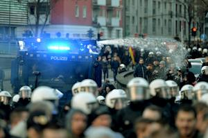 Police use a water cannon in Cologne, western Germany,…