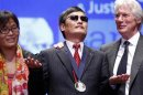 Richard Gere stands with Chen Guangcheng and his wife Yuan Weijing after Chen received The Tom Lantos Human Rights Prize in the Capitol in Washington