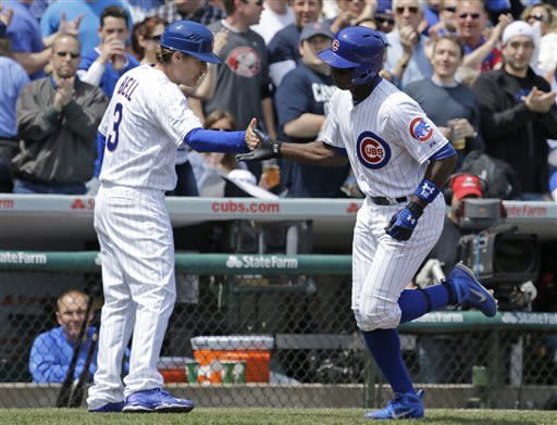Reds rally for 6-4 victory over wild Marmol, Cubs