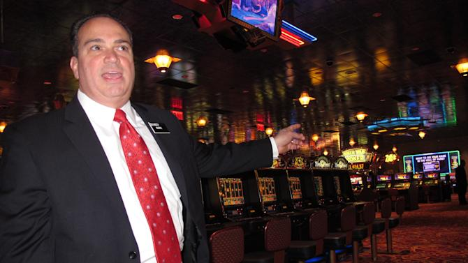 Mark Giannantonio, the new president of Resorts Casino Hotel, discusses the $60 million in renovations and expansion at the Atlantic City N.J. casino in Atlantic City Wednesday Jan. 2, 2013.   Behind him on the casino floor is a slots area slated for renovation. (AP Photo/Wayne Parry)