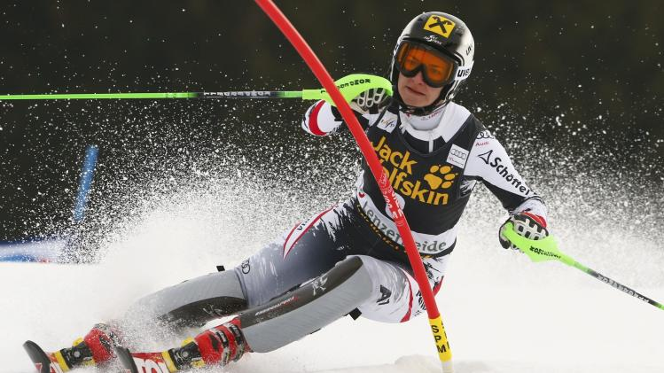 Zettel of Austria clears a pole during the first run of the women's slalom at the FIS Alpine Skiing World Cup Finals in Lenzerheide