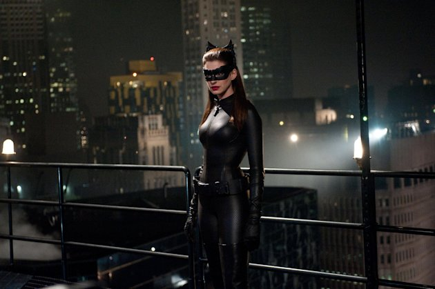 "This undated film image released by Warner Bros. Pictures shows Anne Hathaway as Catwoman in a scene from the action thriller ""The Dark Knight Rises."" A gunman in a gas mask barged into a crowded Denver-area theater during a midnight premiere of the Batman movie on Friday, July 20, 2012, hurled a gas canister and then opened fire, killing 12 people and injuring at least 50 others in one of the deadliest mass shootings in recent U.S. history. (AP Photo/Warner Bros. Pictures, Ron Phillips)"