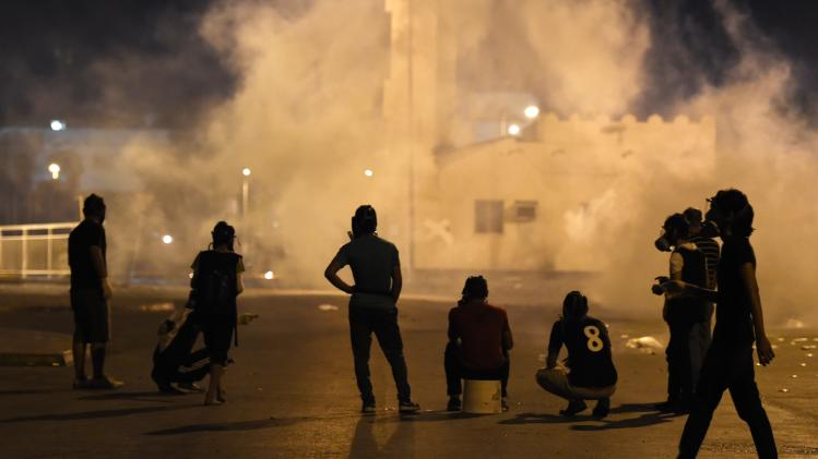 Anti-government protesters clash with riot police in Sitra