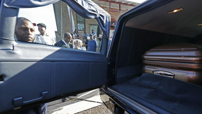 An attendant closes the door to the hearse with the casket bearing the body of blues legend B.B. King in front of the B.B. King Museum and Delta Interpretive Center after a day of public viewing, Friday, May 29, 2015 in Indianola, Miss. The visitation comes a day before the funeral for the man who influenced generations of singers and guitarists. (AP Photo/Rogelio V. Solis)