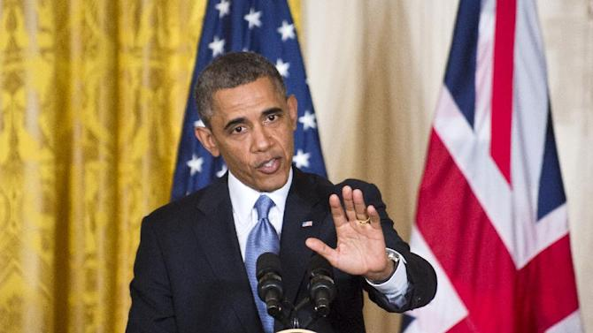 In this photo taken May 13, 2013, President Barack Obama defends his administration's actions in the wake of the attacks on the U.S. consulate in Benghazi, Libya, last year, calling Congressional criticism a political sideshow during a joint news conference with visiting British Prime Minister David Cameron, not shown, at the White House in Washington. The night of smoke, chaos, gunfire and grenades that killed four Americans in Benghazi is well-documented. Eight months later, it is the decisions made back in Washington that remain murky and in perpetual dispute.  (AP Photo/J. Scott Applewhite, File)