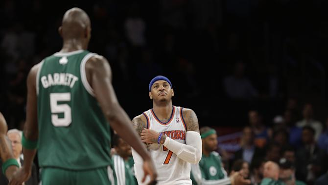 New York Knicks forward Carmelo Anthony (7) reacts as Boston Celtics center Kevin Garnett (5) returns to the bench at the end of Game 5 of their first-round NBA basketball playoff series at Madison Square Garden in New York, Wednesday, May 1, 2013. The Celtics won 92-86. (AP Photo/Kathy Willens)