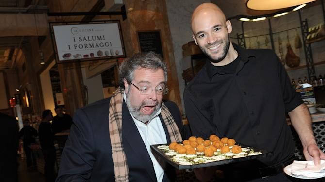 IMAGE DISTRIBUTED FOR FOOD & WINE - Restauranteur Drew Nieporent, left, enjoys himself at a party celebrating Mario Batali's guest-edited April issue of FOOD & WINE, at Eataly in New York, Wednesday, March 6, 2013.  (Photo by Diane Bondareff/Invision for FOOD & WINE/AP Images)