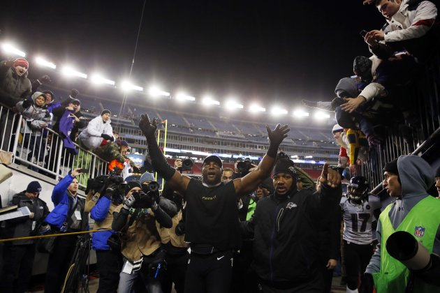 Jan 20, 2013; Foxboro, MA, USA; Baltimore Ravens inside linebacker Ray Lewis (middle) waves to fans as he walks off the field after the AFC championship game against the New England Patriots at Gillette Stadium. The Ravens won 28-13. (David Butler II-USA TODAY Sports)