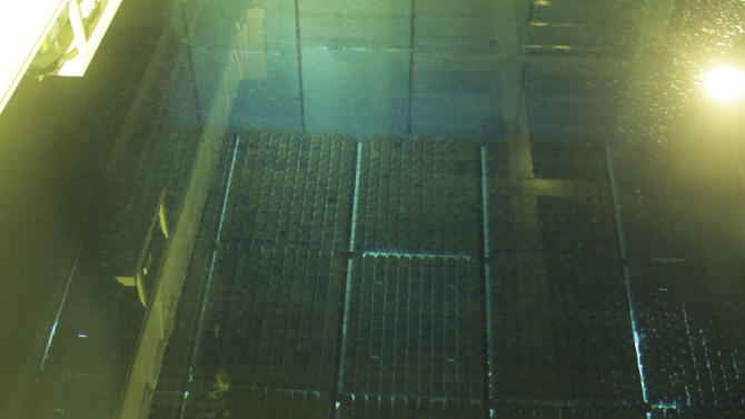 "In this Nov. 8, 2012 photo, spent nuclear fuel rods are stored in a storage pool at the Rokkasho nuclear fuel reprocessing plant, run by Japan Nuclear Fuel Ltd. in Rokasho village in Aomori Prefecture, northern Japan. By hosting a high-tech facility that would convert spent fuel into a plutonium-uranium mix designed for the next generation of reactors, Rokkasho was supposed to provide fuel while minimizing nuclear waste storage problems. Those ambitions are falling apart because years of attempts to build a ""fast breeder"" reactor, which would use the reprocessed fuel, appear to be ending in failure. (AP Photo/Koji Sasahara)"
