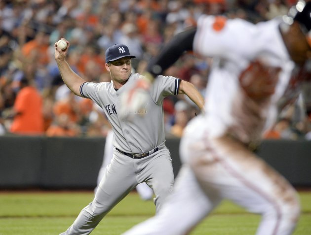 New York Yankees Warren throws out Baltimore Orioles Jones during fifth inning of their MLB American League baseball game in Baltimore