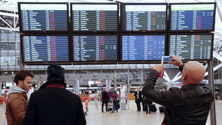 Passenger takes photo of departure board showing flights cancelled due to storm at airport Fuhlsbuettel in Hamburg
