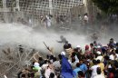 Egyptian security forces, unseen, fire a water cannon at protesters during clashes outside the Ministry of Defense in Cairo, Egypt, Friday, May 4, 2012. Egyptian armed forces and protesters clashed in Cairo on Friday, with troops firing water cannons and tear gas at demonstrators who threw stones as they tried to march on the Defense Ministry, a flashpoint for a new cycle of violence only weeks ahead of presidential elections. (AP Photo/Ahmed Gomaa)