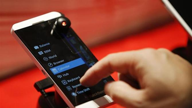A person uses the new Blackberry Z10 device at a Rogers store in Toronto February 5, 2013. REUTERS/Mark Blinch/Files