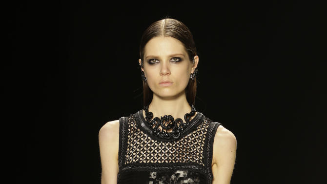 CORRECTS DATE - A model wears a creation for Roberto Cavalli women's Fall-Winter 2013-14 collection, part of the Milan Fashion Week, unveiled in Milan, Italy, Saturday, Feb. 23, 2013. (AP Photo/Luca Bruno)