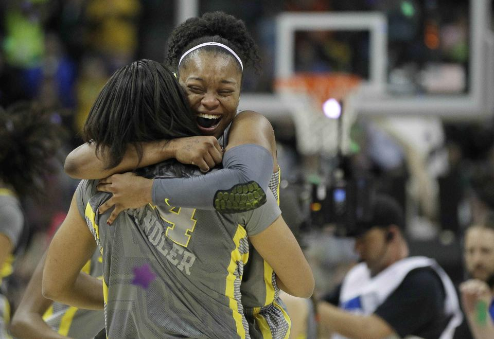 Baylor guard Odyssey Sims (0) and Baylor Mariah Chandler (44) embrace after the NCAA Women's Final Four college basketball championship game against Notre Dame, in Denver, Tuesday, April 3, 2012. Baylor won the championship 80-61. (AP Photo/Julie Jacobson)