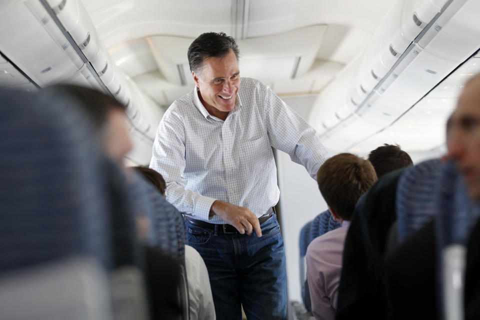 Republican presidential candidate, former Massachusetts Gov. Mitt Romney talks to staff on his campaign plane en route from Reno to Elko, Nev., Feb. 3, 2012. (AP Photo/Gerald Herbert)