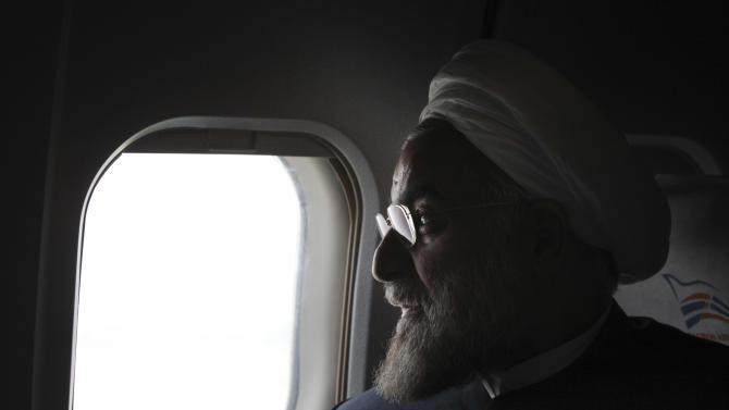 """In this Monday, June 10, 2013, Iranian President elect, Hasan Rouhani, a former Iran's top nuclear negotiator, looks on, in his plane, during his presidential election campaign tour to the northwestern, Iran. Just a week before Iran's election gatekeepers announced the presidential ballot, Rouhani described the U.S. as the world's """"sheriff"""" and said direct talks with Washington are the only way for breakthroughs in the nuclear standoff. (AP Photo/Vahid Salemi)"""