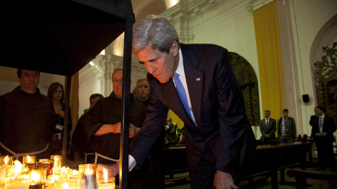 U.S. Secretary of State John Kerry lights a candle during his visit to San Francisco Church in Antigua Guatemala, Tuesday, June 4, 2013. Kerry is in Guatemala for the annual general assembly of the Organization of American States (OAS). (AP Photo/Moises Castillo)