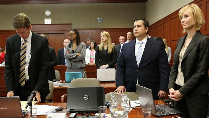 Defense attorney Mark O'Mara, left, George Zimmerman, second from right, and attorney Lorna Truett, stand at the start of court on day 13 in George Zimmerman's trial in Seminole circuit court in Sanford, Fla. Wednesday, June 26, 2013. Zimmerman has been charged with second-degree murder for the 2012 shooting death of Trayvon Martin. (AP Photo/Orlando Sentinel, Jacob Langston, Pool)