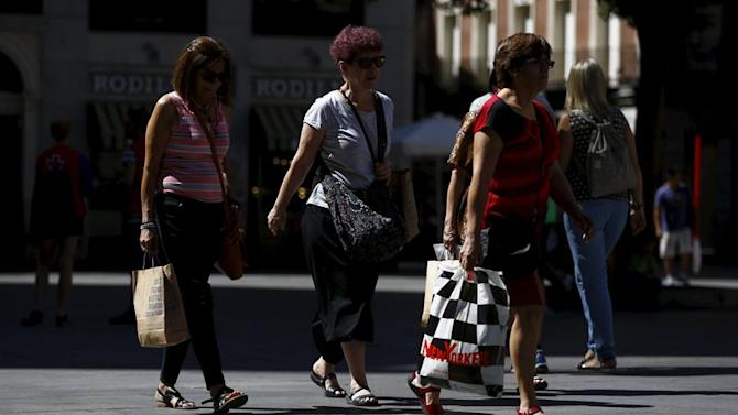Women carry shopping bags as they walk in central Madrid | View photo ...