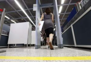 passenger walks through a security checkpoint at Frankfurt Airport