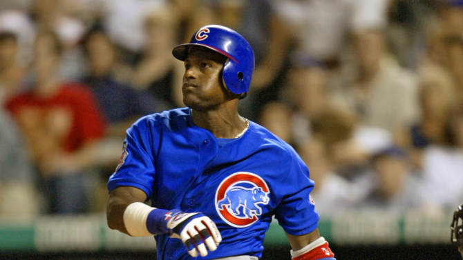 FILE - This Aug. 4, 2004, file photo shows Chicago Cubs' Sammy Sosa watching a three-run home run off Colorado Rockies relief pitcher Scott Dohmann during the seventh inning of a baseball game at Coors Field in Denver. Baseball's all-time home run king and its most decorated pitcher likely will be shut out of the Hall of Fame when the vote is announced in January. An AP survey shows that Barry Bonds and Roger Clemens, as well as Sammy Sosa, don't have enough votes to get into Cooperstown.  (AP Photo/Jack Dempsey, File)