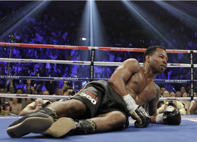Shane Mosley lays on the mat after being knocked down by Manny Pacquiao in the third round during a WBO welterweight title bout, Saturday, May 7, 2011, in Las Vegas.  (AP Photo/Isaac Brekken)