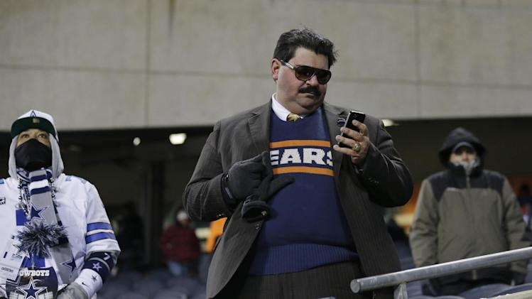 A Chicago Bears fan dressed as former Chicago Bears player and football coach Mike Ditka is seen in the stands before an NFL football game between the Bears and the Dallas Cowboys, Monday, Dec. 9, 2013, in Chicago. Mike Ditka will have his No. 89 retired during a halftime ceremony