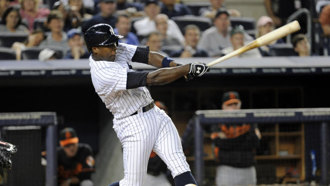 New York Yankees' Alfonso Soriano hits a two-run home run during the fourth inning of a baseball game against the Baltimore Orioles, Friday, Aug. 30, 2013, at Yankee Stadium in New York. (AP Photo/Bill Kostroun)