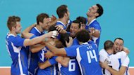 Italy's players celebrate winning their men's bronze medal volleyball match against Bulgaria at Earls Court during the London 2012 Olympic Games