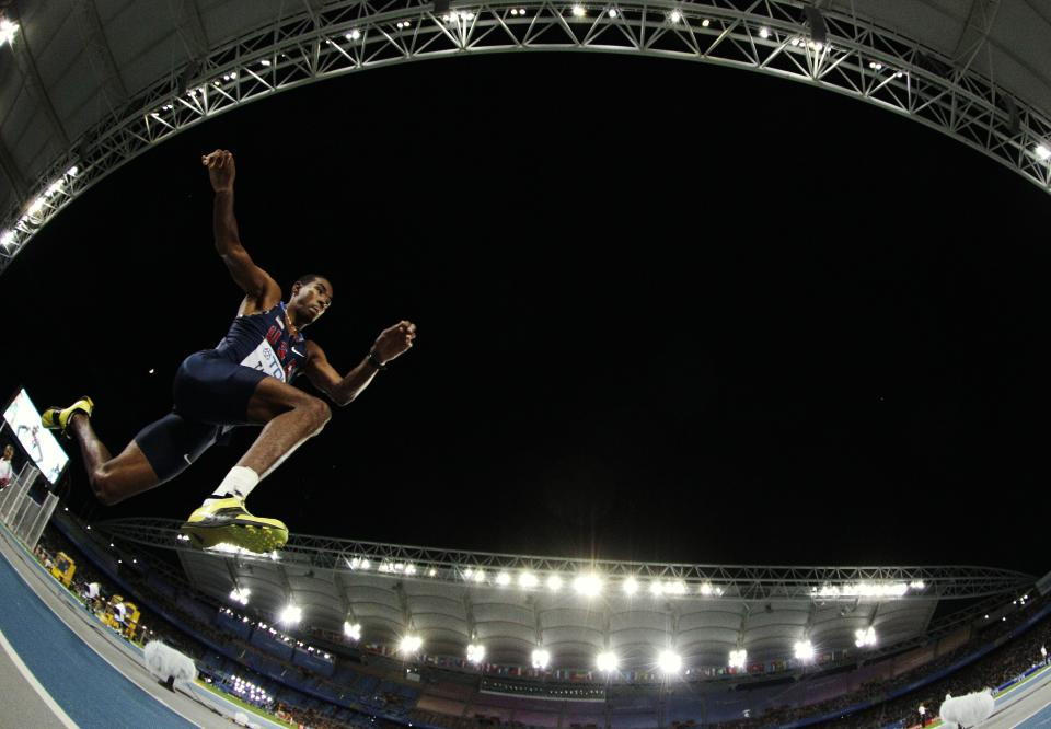 USA's Christian Taylor makes an attempt in the Men's Triple Jump final at the World Athletics Championships in Daegu, South Korea, Sunday, Sept. 4, 2011. (AP Photo/David J. Phillip)