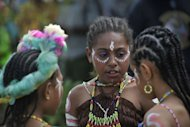 Papuan children at the Lake Sentani festival in the Jayapura district of the Indonesian eastern province of Papua. Some 80 percent of New Guinea's people live in rural areas and many tribes, especially in the isolated mountains, have little contact with one another, let alone with the outside world